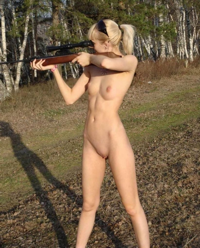 naked girl shooting gun